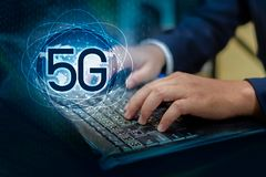 phone computer 5g Earth businessman connect worldwide waiter hand holding an empty digital tablet with smart and 5G network royalty free stock photo