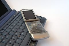 Phone and computer keyboard Stock Images