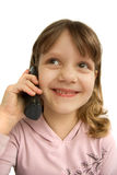 Phone conversation. Smiling preschool girl talking on home phone, isolated over white Royalty Free Stock Photography