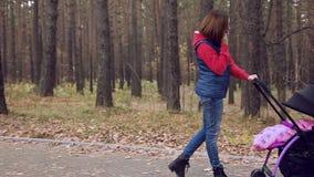 Phone conversation in autumn park stock video footage