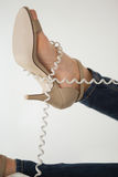 Phone cord wrapped around womans foot Stock Images