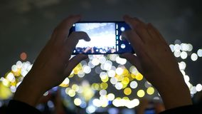 Phone crowd lights concert. Bokeh background of crowd with lights at the concert stock footage