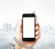 Phone cuffed to hand Royalty Free Stock Photography