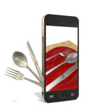 Phone and cutlery. Phone with fork, spoon, table knife on a white background Stock Images