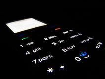 Phone in dark. Mobil phone in dark with light keypad Royalty Free Stock Images