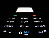 Phone in dark. Mobil phone in dark with light keypad Royalty Free Stock Photos