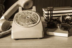 Phone on the desk. Old telephone and stationery on the desk Royalty Free Stock Photos