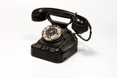 Phone dialer. A phone with a rotary dialer on a white background with a wired phone royalty free stock photo