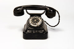 Phone dialer. A phone with a rotary dialer on a white background with a wired phone stock image