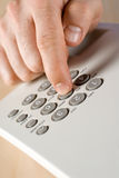 Phone dialing. Man touching phone dial pad Royalty Free Stock Image