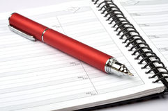 Phone diary. Note book with red pen Royalty Free Stock Images