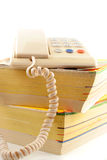 Phone directories. Home telephone on top of phone directories Stock Images