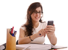 Phone distraction. Student adult woman stop her study time for send a phone sms stock photography