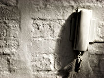 Phone on distressed wall. Landscape photo of phone on distressed wall royalty free stock image