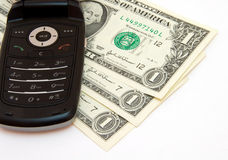 Phone and dollars. Mobile phone and dollars on white background Stock Photography