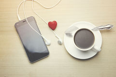 Phone, earphone, coffee and heart. Phone, earphone, cup of coffee and red heart Royalty Free Stock Photos