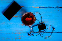 Phone Earphones and a top view of tea Stock Photography