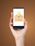 Phone with email. Hand holding phone with email, close up Royalty Free Stock Photography