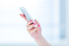 Phone in female hand Royalty Free Stock Image