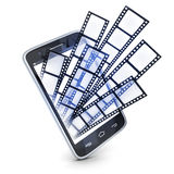 Phone and films. On white background (done in 3d rendering Royalty Free Stock Photos