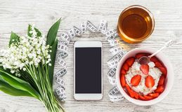 Phone fitness application and light breakfast Royalty Free Stock Photography