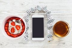 Phone fitness application and light breakfast Stock Images