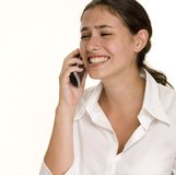 Phone Frustration. A young woman has a look of anguish as she receives a telephone call Royalty Free Stock Images
