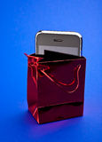 Phone in gift packet Stock Photography