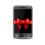 Phone in gift ribbon Royalty Free Stock Photos