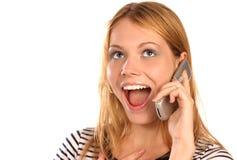 Phone gossip. Beautiful girl having interesting conversation on phone, close up, isolated on white Stock Photos