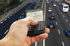 Phone with GPS. Close up with an highway on the background royalty free stock photo