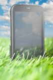 Phone in grass Royalty Free Stock Images