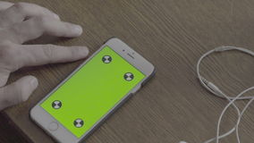 Phone with green background stock video footage