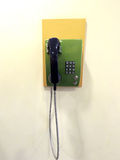 Phone green hanging on the wall Stock Photography