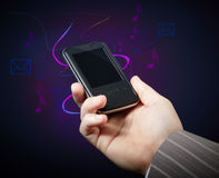 Phone in hand. Multimedia on background Stock Photo