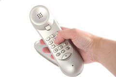 Phone in hand. Photo of the beautiful tone dial silver phone Royalty Free Stock Images