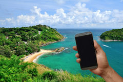 Phone on hand with blank screen in beautiful travel location bac Stock Photo