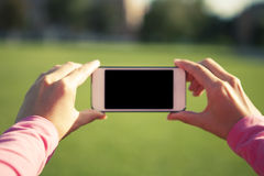 Phone in hand Stock Image