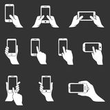 Phone in hand icons, hands holding smartphone, vector icon set. Icon set of hands holding smart phone Stock Photo