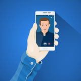 Phone in hand vector illustration in flat style. Mans hand holding a phone concept. Stock Photos