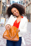 Phone and handbag Royalty Free Stock Images