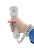 Phone handset. Man hand hold a phone handset Royalty Free Stock Image