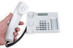 Phone handset in hand Stock Image
