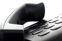Phone Handset on Hold over Slick Telephone Keypad Stock Image