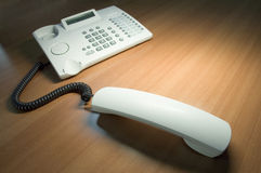 Phone handset off. Phone handset is off and on the table desk royalty free stock photos