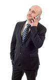 On the phone. Happy business man on the phone, isolated Royalty Free Stock Image