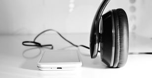 Phone with headphones. Black and white photo with phone headset Royalty Free Stock Images