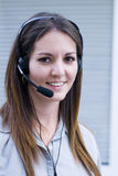 Phone headset professional. Happy professional phone operator ansers telephone call Stock Photo