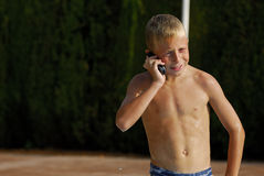 Phone-home. Young wet boy making a phone call royalty free stock photography
