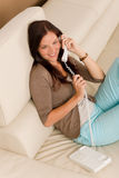 On the phone home smiling woman calling. Home attractive smiling woman calling phone in living room royalty free stock photos